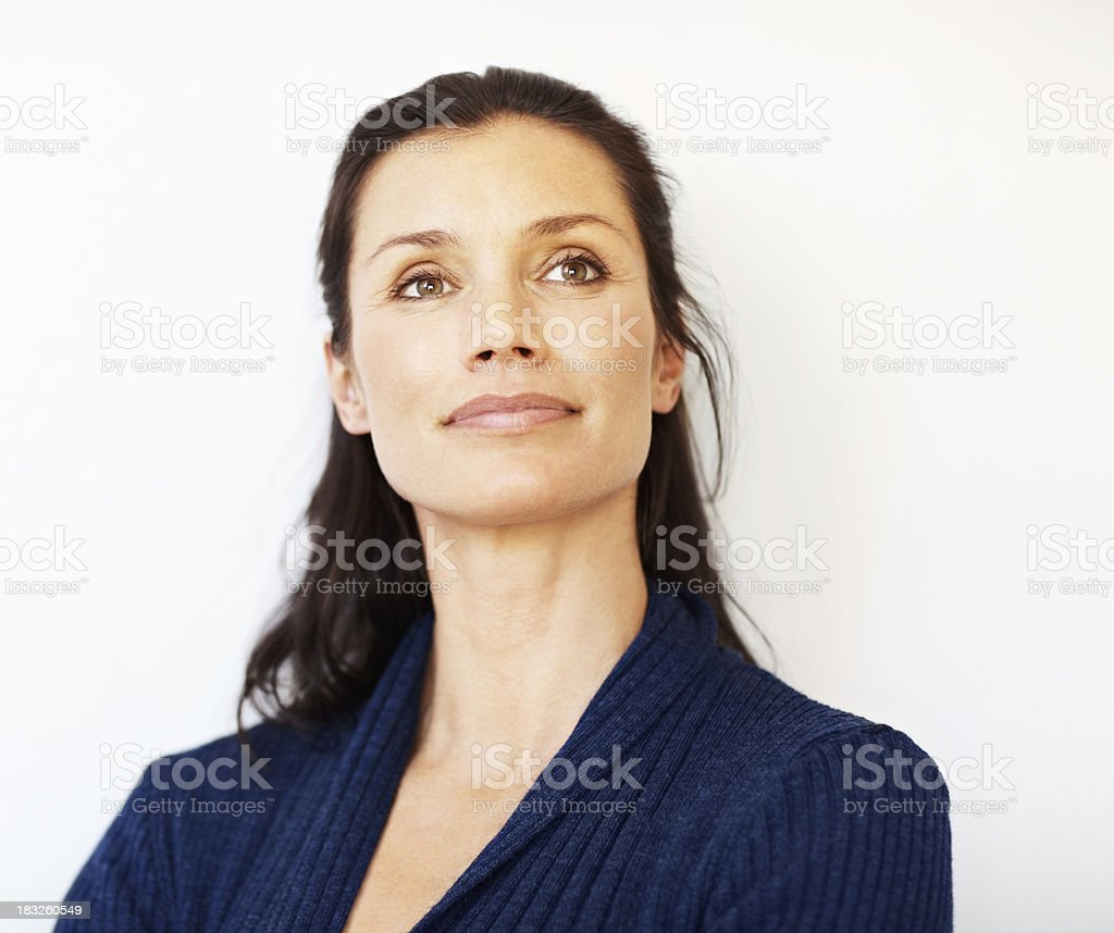 Relaxed middle aged woman looking away at copyspace stock photo