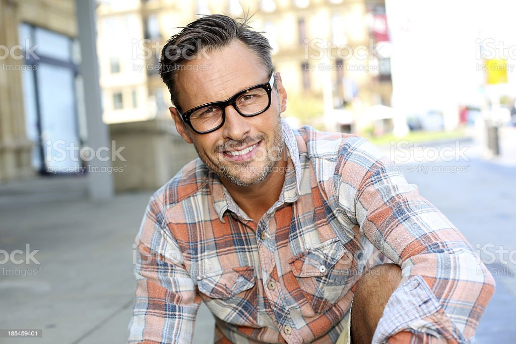 Relaxed middle-aged man in the street stock photo
