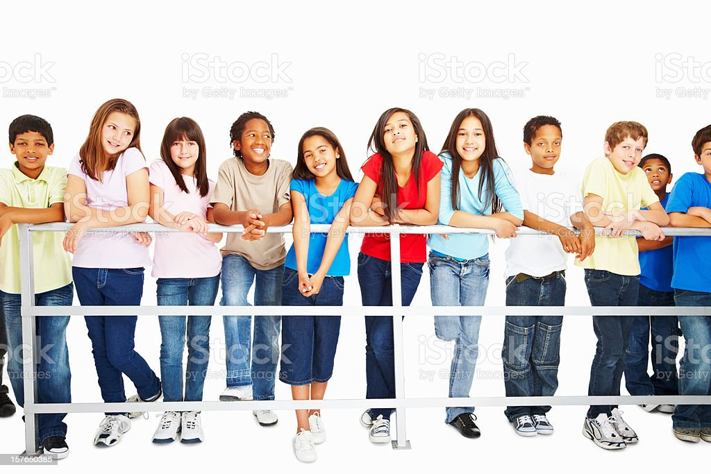 Relaxed multi ethnic kids leaning on railing royalty-free stock photo