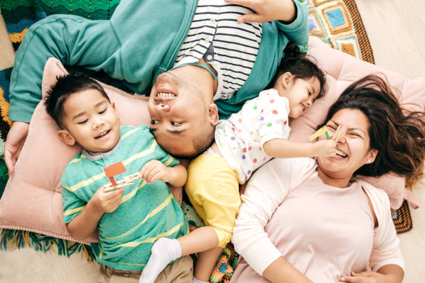 Relaxed parenting Family at home filipino ethnicity stock pictures, royalty-free photos & images