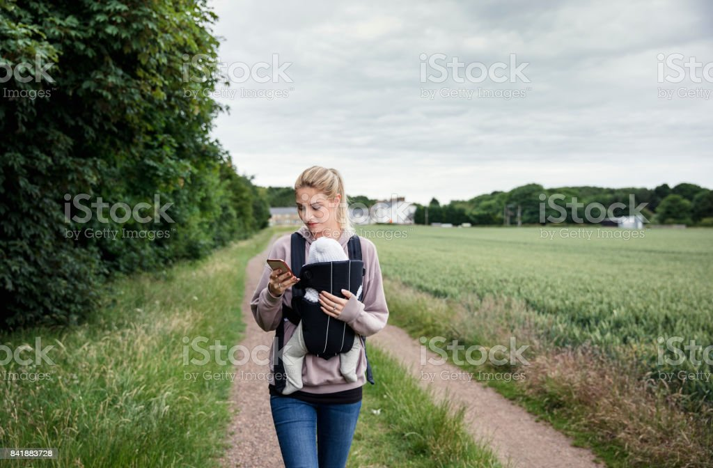 Relaxed Parenting Walking Through the Field stock photo