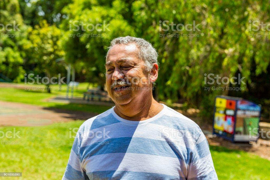 Relaxed Portrait of an Australian Aboriginal Man stock photo