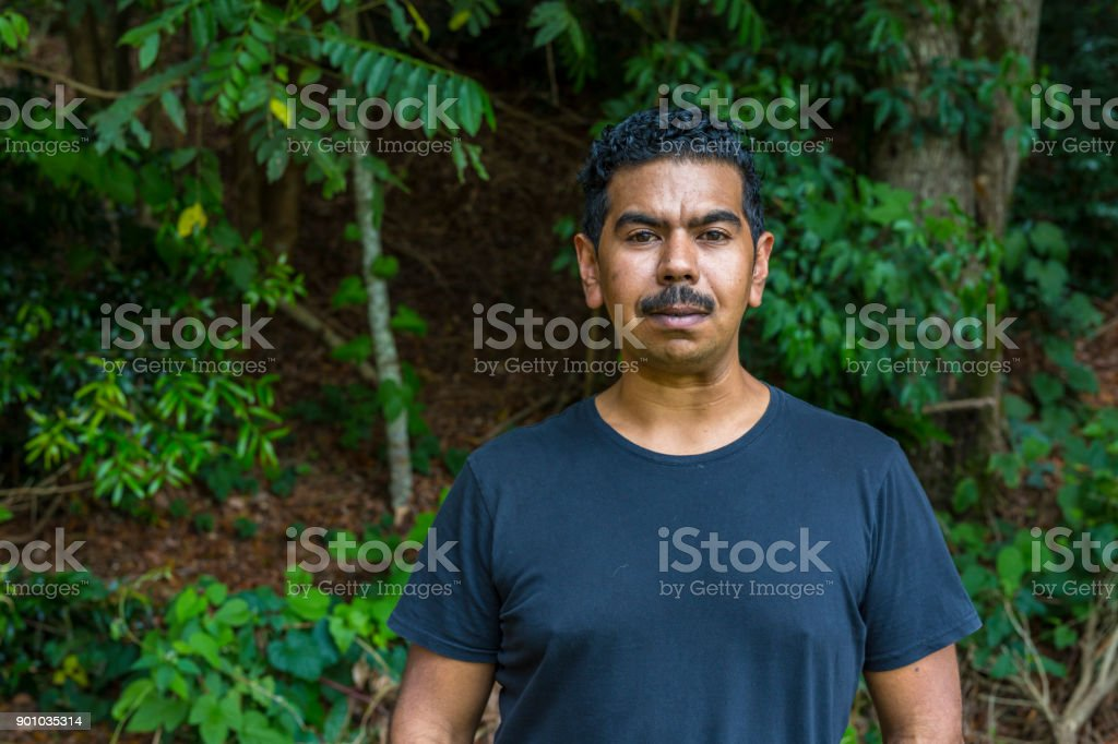 Relaxed Portrait of an Australian Aboriginal Young Man stock photo