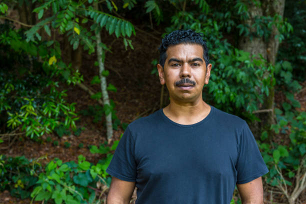 relaxed portrait of an australian aboriginal young man - day in the life series stock pictures, royalty-free photos & images