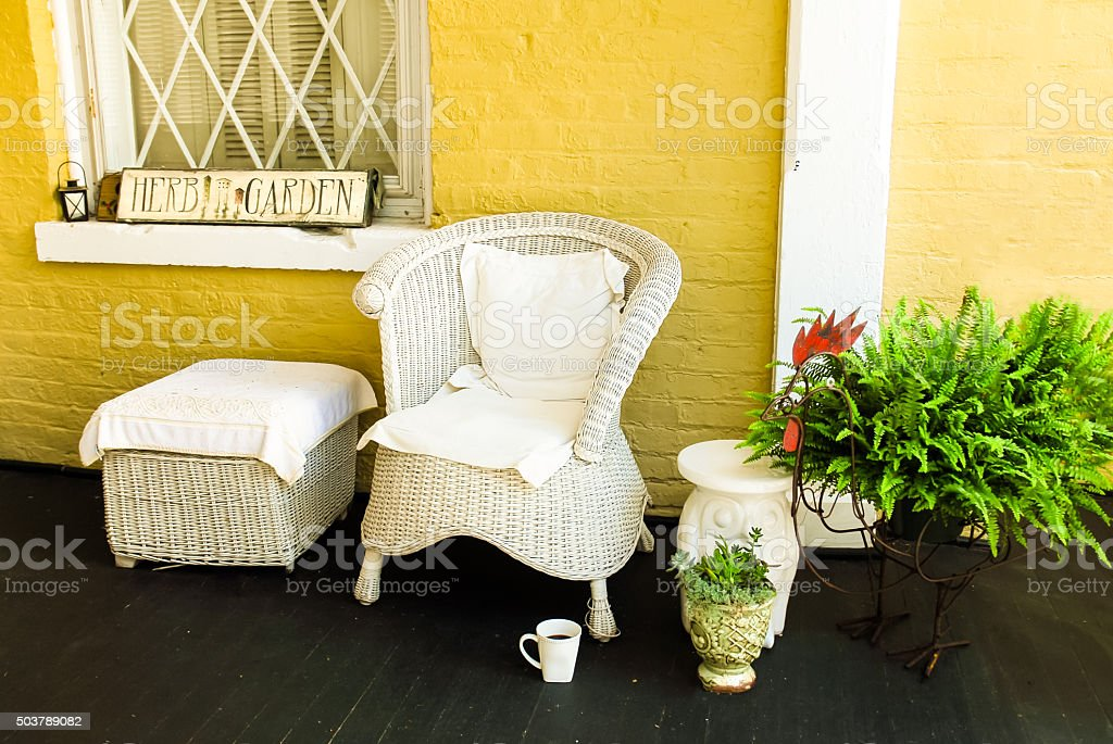 Relaxed Setting of Wicker on a Porch stock photo