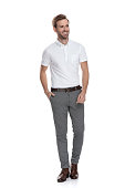 istock relaxed smiling smart casual man looks to side 1131989486