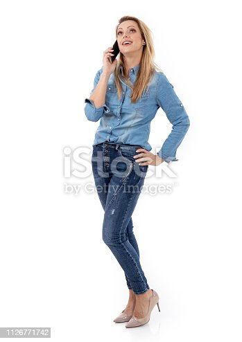 istock Relaxed smiling woman talking on the phone 1126771742