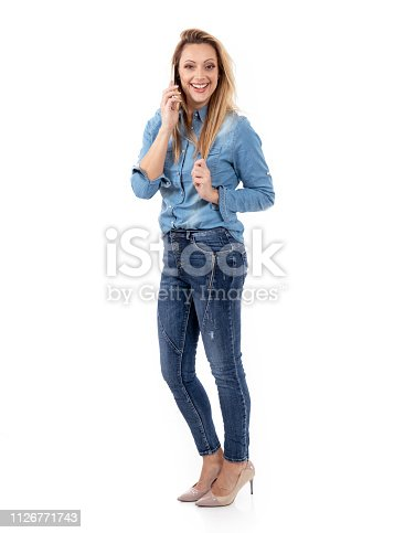 istock Relaxed smiling woman talking on the phone 1126771743