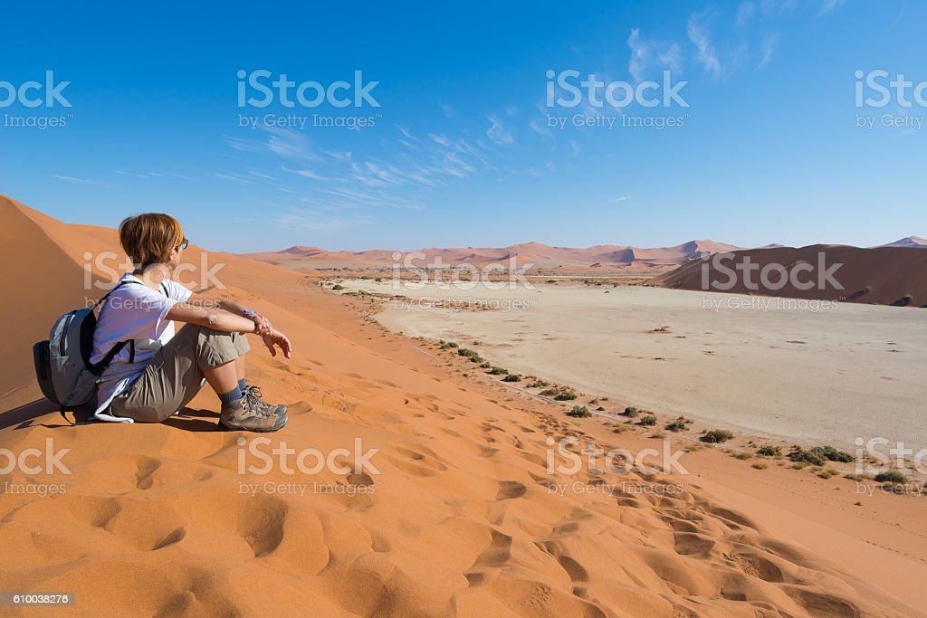 Relaxed tourist looking at view in Sossuvlei, Namib desert stock photo