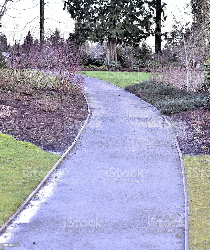 Relaxed walkway in the park royalty-free stock photo