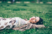 Young woman relaxing in the grass