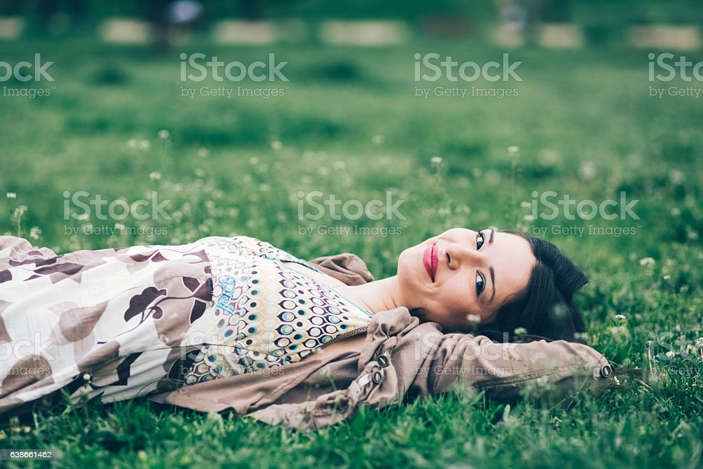 Relaxed woman among nature stock photo