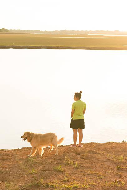 Relaxed woman and dog enjoying summer sunset picture id639593216?b=1&k=6&m=639593216&s=612x612&w=0&h=r6mn5g1g8po6fy2q6j6zj3ykzu4 16nsvx8fsn2luwy=