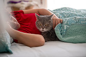 Woman and cat sleeping together.