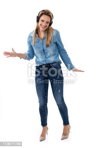 istock Relaxed woman dancing to music, using headphones 1126771750