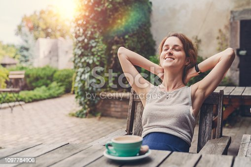 Smiling woman enjoying the weekend among nature