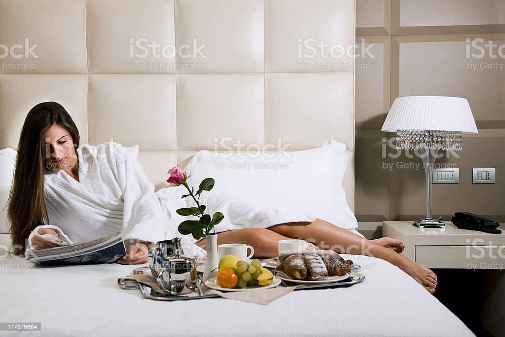 Relaxed Woman Having Breakfast in Bed royalty-free stock photo