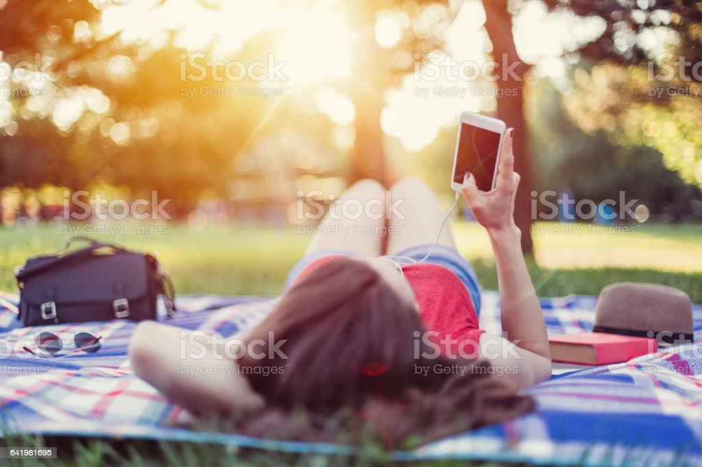 Relaxed woman in the city park stock photo