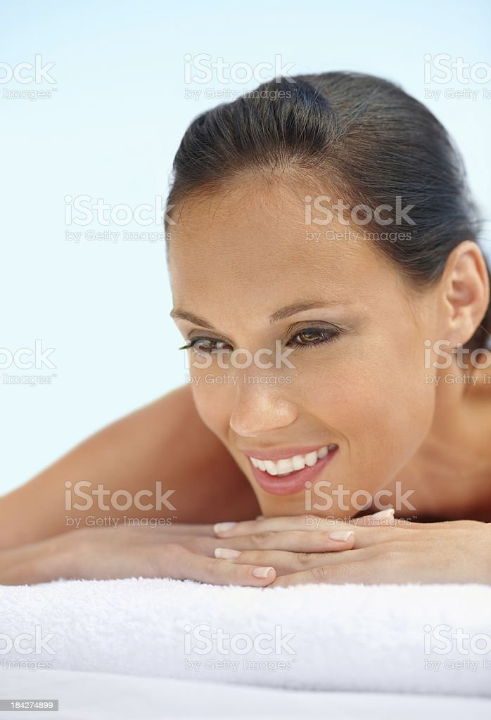 Relaxed woman lying at spa stock photo