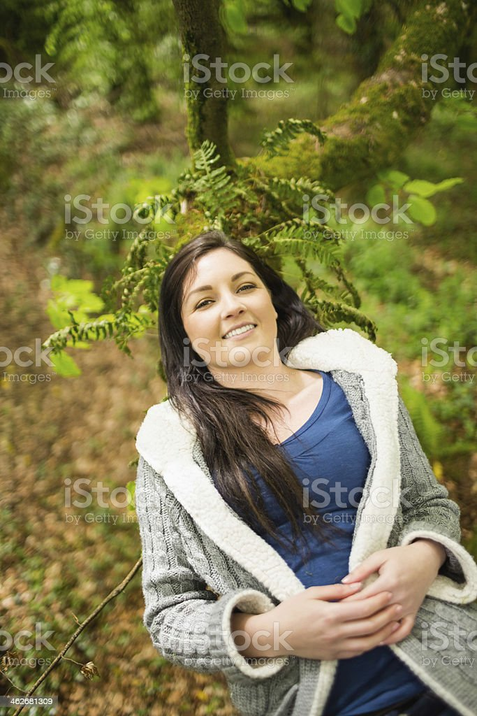 Relaxed woman lying on a tough branch royalty-free stock photo