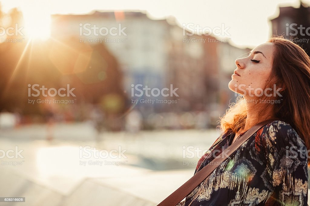 Relaxed woman outside stock photo
