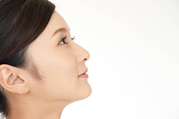 リラックスした女性 - 女性 横顔 日本人 ストックフォトと画像