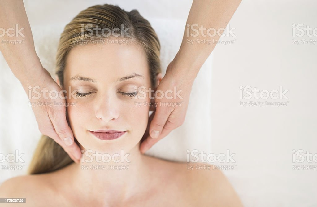 Relaxed Woman Receiving Head Massage In Health Spa royalty-free stock photo