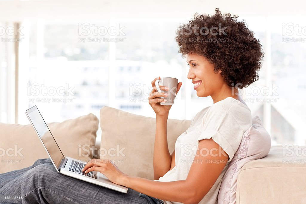 Relaxed Woman Using Laptop royalty-free stock photo