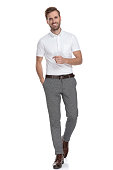 istock relaxed young casual man walks forward with hand in pocket 1131989393