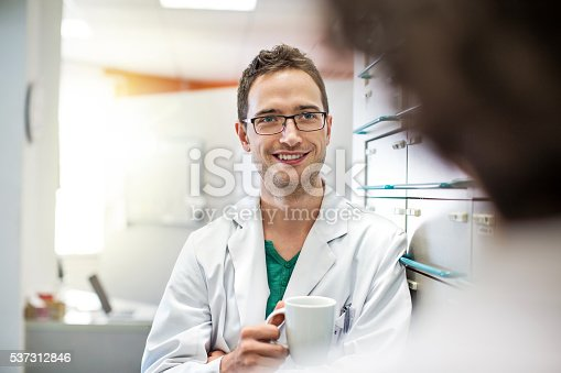 istock Relaxed young male pharmacists with a cup of coffee 537312846
