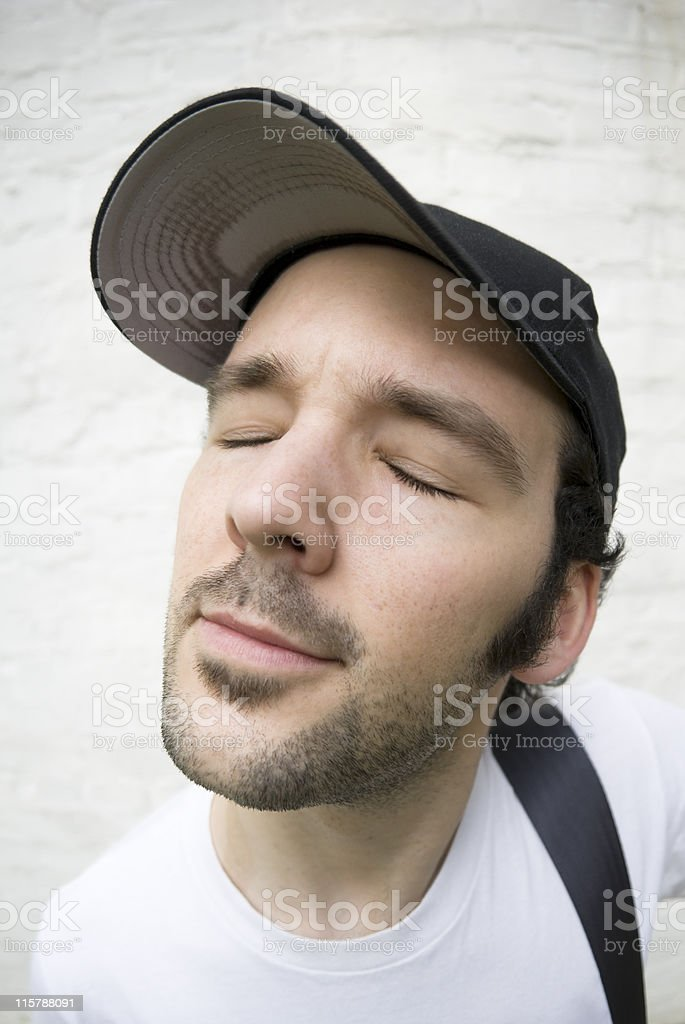 Relaxed young man, closed eyes, fisheye portrait royalty-free stock photo