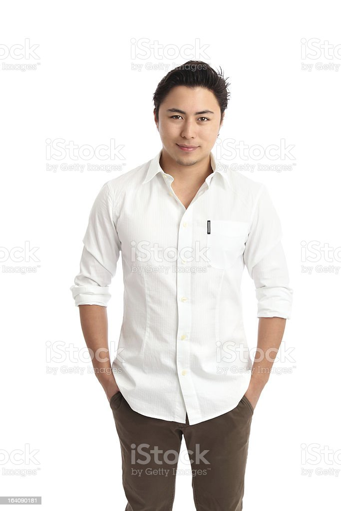 Relaxed young man in a white shirt stock photo