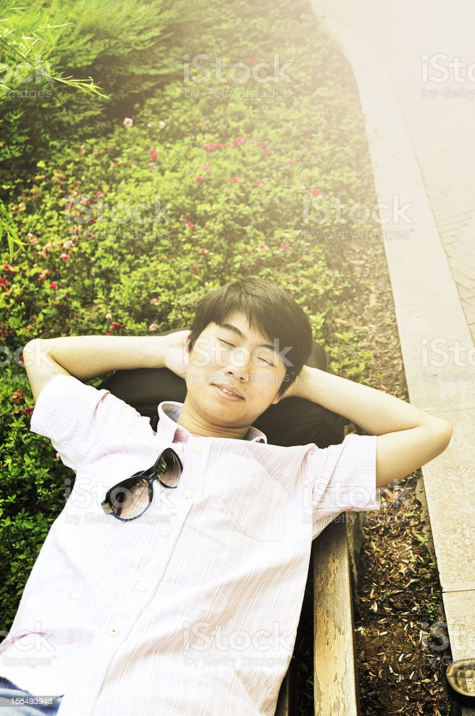 relaxed young man resting in forest park royalty-free stock photo