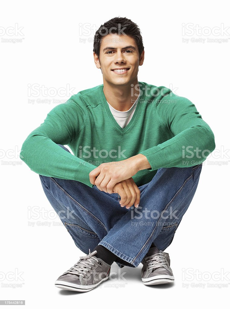 Relaxed Young Man Sitting On Floor - Isolated stock photo
