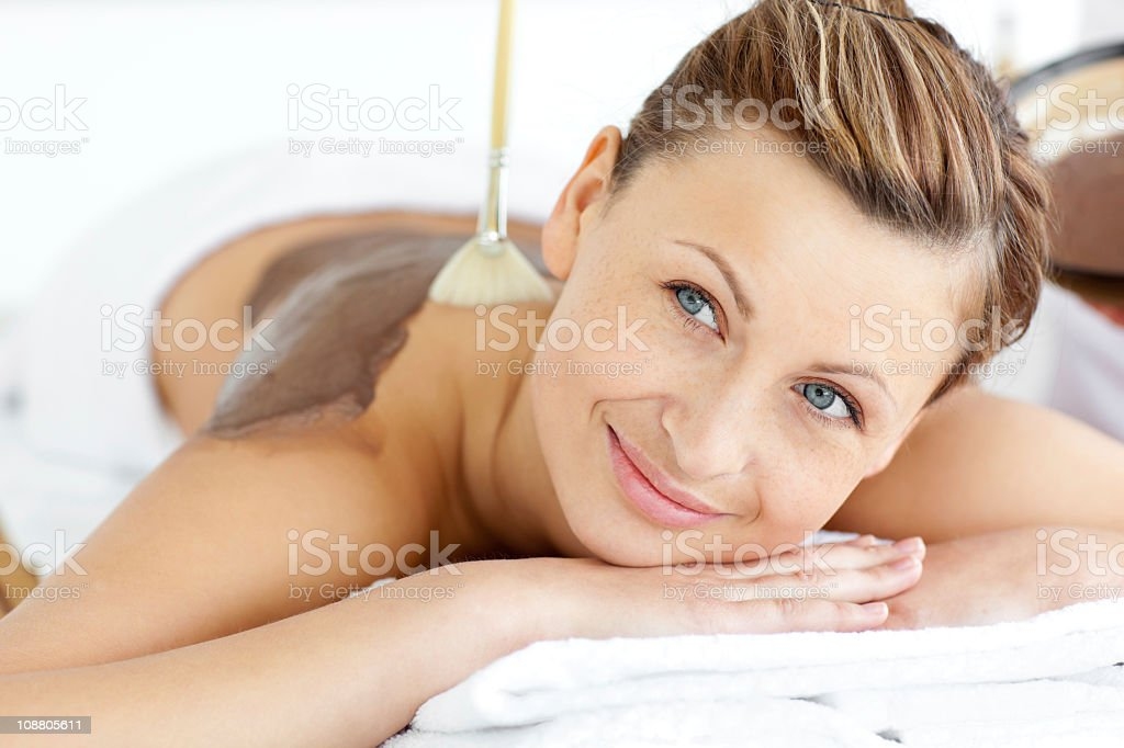 Relaxed young woman enjoying a beauty treatment royalty-free stock photo