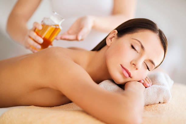 Relaxed young woman receiving a massage stock photo