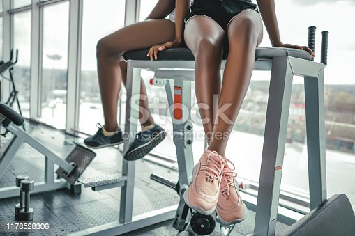 istock Relaxing after training.beautiful young woman looking away while sitting at gym.young female at gym taking a break from workout. 1178528306