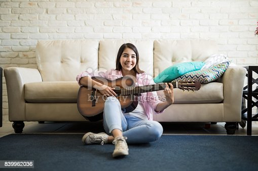 istock Relaxing afternoon playing the guitar 839962036