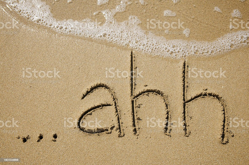 Relaxing ...ahh Message Handwritten in Sand stock photo