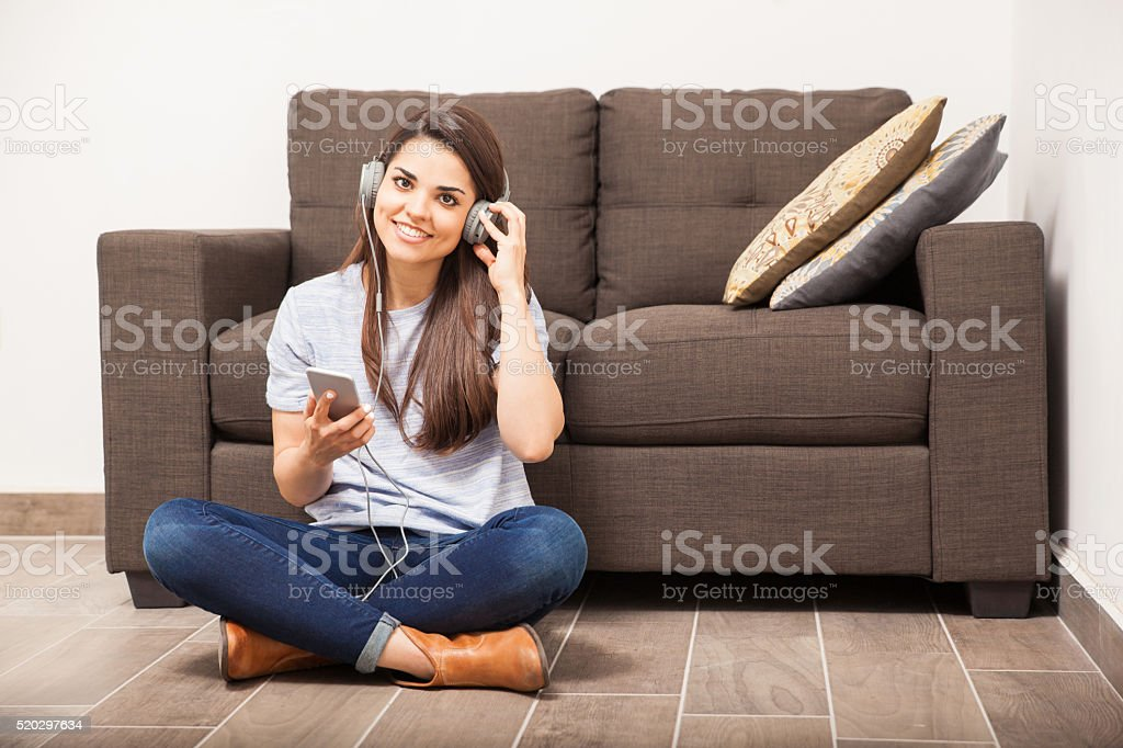 Relaxing and listening to music at home stock photo