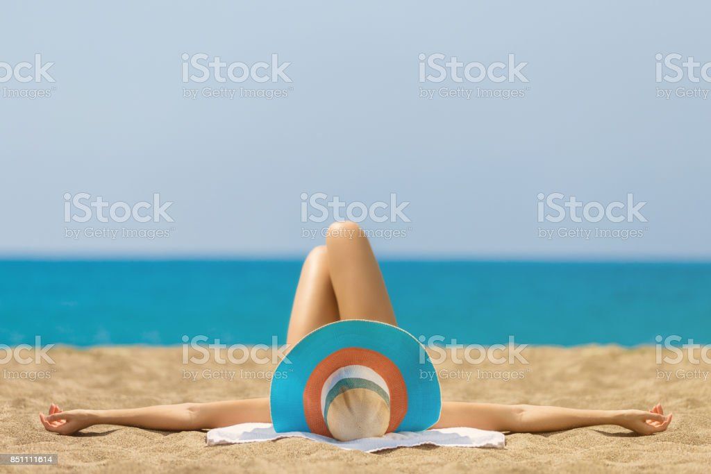 Relaxing and Sunbathing at Beach stock photo