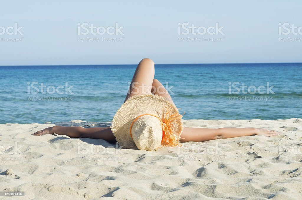 Relaxing and Sunbathing at Sun stock photo