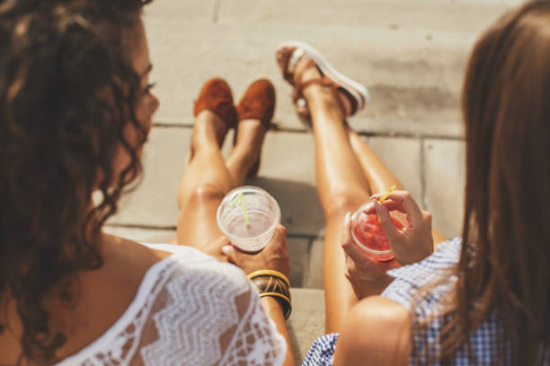 relaxing and tanning - drinking juice stock photos and pictures