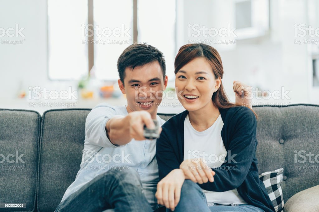 Asian couple Relaxing and watching TV at home