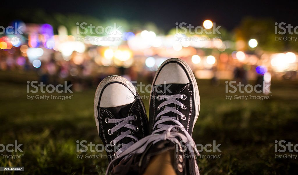 Relaxing at an evening festival stock photo