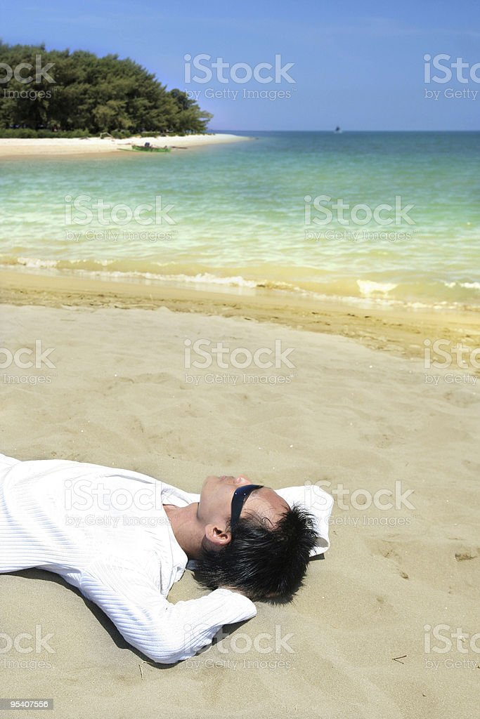 relaxing at beach royalty-free stock photo