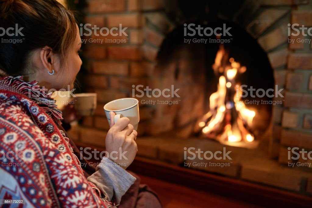 Relaxing at fireplace royalty-free stock photo