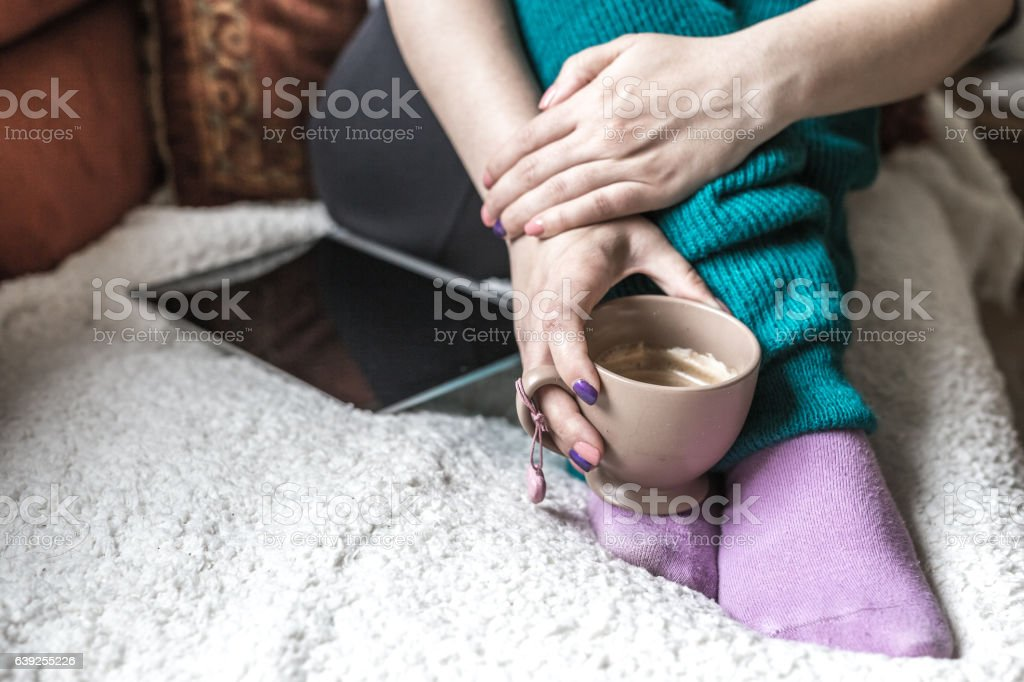 Relaxing at home with coffee and tablet stock photo