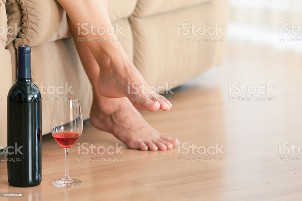 Relaxing at home with glass of wine royalty-free stock photo