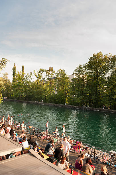 Relaxing at the banks of Limmat, Zurich, Swiss